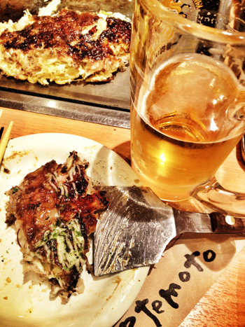 okonomiyaki is a Japanese savoury pancake with  a whole lot of stuff inside