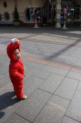 random shot of a cute little kid... in an Elmo costume! awww...